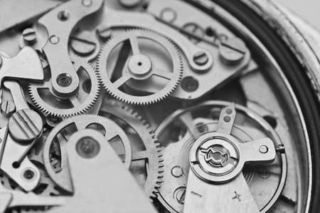 eternity: Black and white macro photo close-up view of metal clockwork. Concept eternity, teamwork