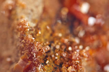 halide: Crystals Vanadinite is a mineral belonging to the apatite group of phosphates,  chemical formula Pb5VO43Cl.  Macro. Extreme closeup