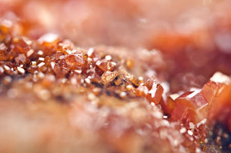 Crystals Vanadinite is a mineral belonging to the apatite group of phosphates,  chemical formula Pb5VO43Cl.  Macro. Extreme closeup