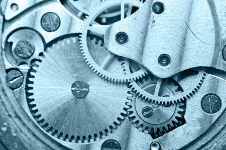 old macro: Gear wheels inside clock. Concept Teamwork , Idea Technology. Macro