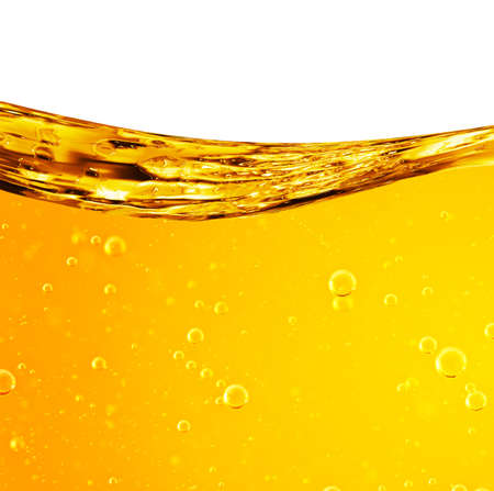 Liquid flows yellow, for the project, oil, honey, beer or other variants, area for text Standard-Bild