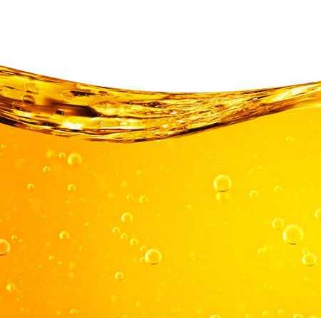 Vloeistof stroomt geel, voor het project, olie, honing, bier of andere varianten, ruimte voor tekst Stockfoto