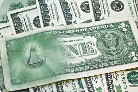eye of providence: Dollar USA. image of United States one-dollar bill, pyramid, Eye of Providence, Beams from pyramid every which way, over banknotes hundred dollars. Conceptual photo for successful business design. Macro. Stock Photo