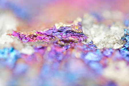 halide: Bornite ore crystallizes mineral its blurred natural background. Macro. Focus on the central. Very shallow depth of field