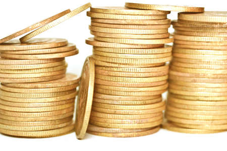 bidding: Economical concepts. Golden coins on white background. Coins stacked on each other.