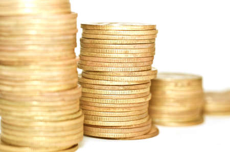 bidding: Economical concepts. Golden coins on white background. Coins stacked on each other. Macro