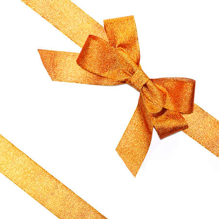 Golden sparkling holiday bow with ribbon on white background
