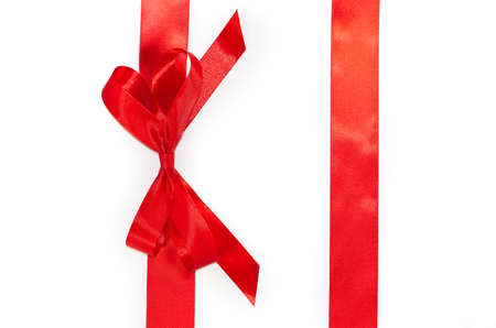 Red vertical gift ribbons and luxurious bow isolated on white background Stock Photo