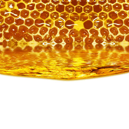 Honey flowing  from honeycombs and a wave on a white background