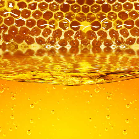 beeswax: Honey flowing  from honeycombs and a wave