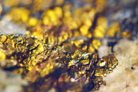 Golden  Abstract background from natural mineral. Macro