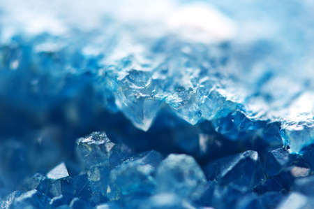 Winter cold background  blue crystals Macro.