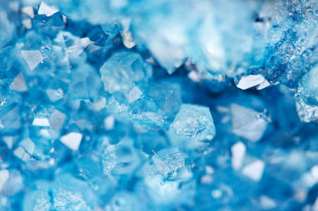 Beautiful texture of Blue crystals. mineral its blurred natural background. Winter Beautiful background. Macro closeup. 스톡 콘텐츠