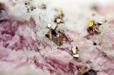 Pink crystals Rhodochrosite with particles of Pyrite. Natural  texture of mineral for background. Beautiful background and wallpaper. Macro Stock Photo