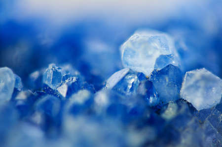 Winter beautiful background of beautiful  of blue crystals. Macro shooting. 스톡 콘텐츠