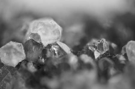 Black and white photograph of the structure of the surface of crystals. Close-up. Blurred background