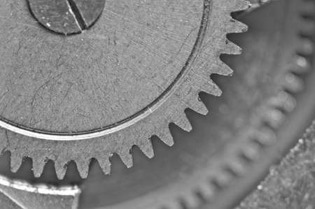 Concept Teamwork or successful business design. Black and white photo background  of old metal gears or parts. Macro