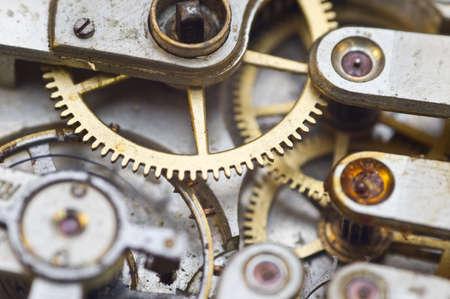 Mecanismo de relojería, engranajes en un reloj antiguo. Concepto de trabajo en equipo, idea, tecnología, eternidad, negocios. Macro Foto de archivo
