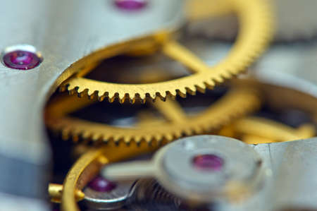 Cog wheels. Yellow gears, clockwork. The concept of time, teamwork, success