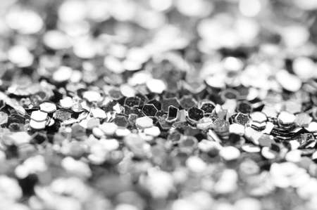 Black-and-white background from confetti, focus in the center, bokeh at the edges