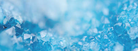 Winter Background with Blue Cold Crystals, with Beautiful Light. Copy Space. Banner format.