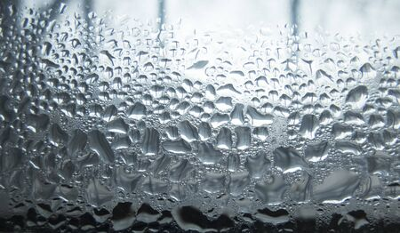 creative idea for background. bokeh from raindrops on glass Banque d'images