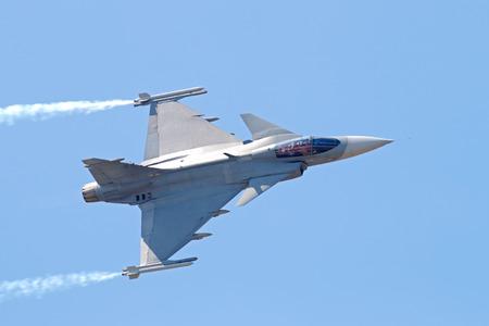 Military Fighter Jet on blue sky