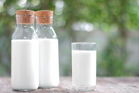 Milk bottle and milk glass on wooden table Stok Fotoğraf