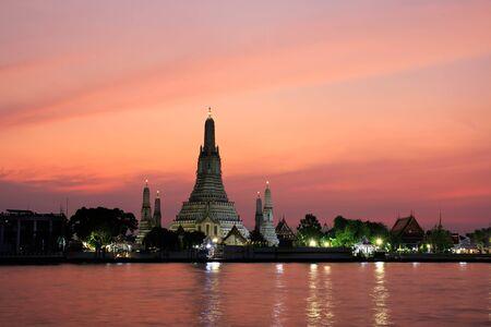 Wat Arun Ratchawararam Temple of Dawn at sunset landmark of bangkok