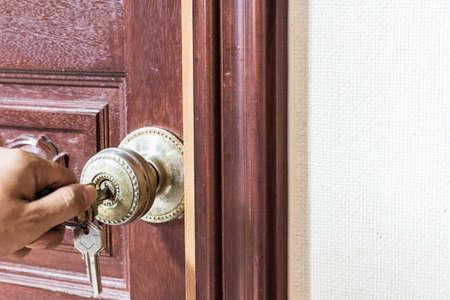 man hand Locking the Door
