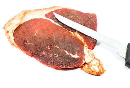 sappy: Knife cut of beef steak on white Isolated