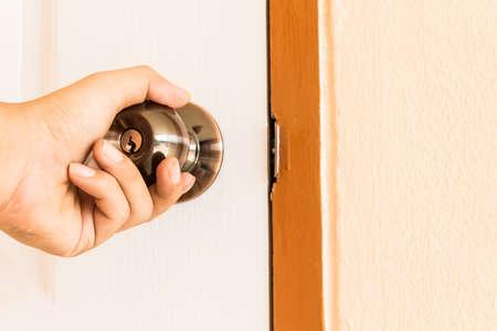 door knob: Man hand open door knob