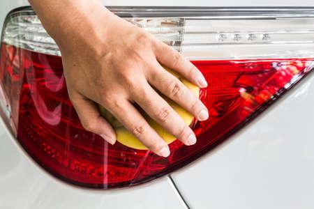 rag wheel: man washing a car - car care Stock Photo