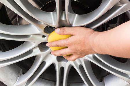 rag wheel: Hand applying polish car wheel