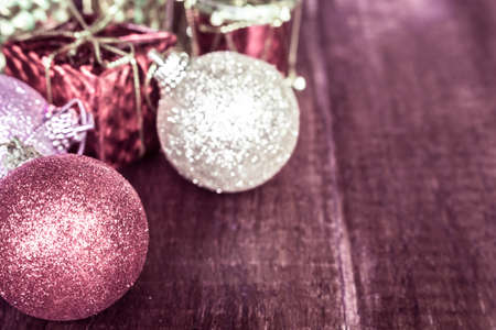 enrich: Christmas baubles red and silver on wood table