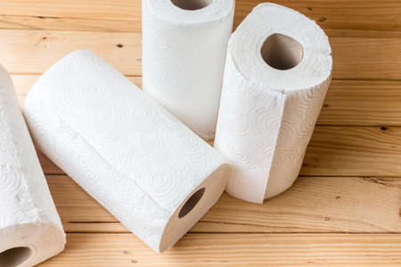 toilet: Roll of paper towel on wooden background