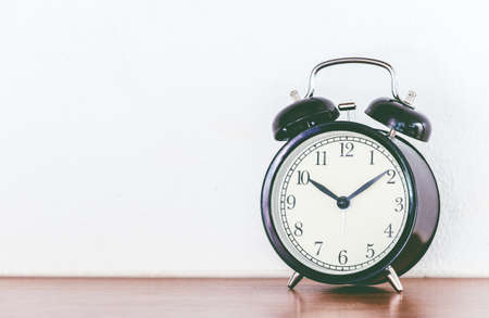 Alarm clock on a wooden table Stock Photo