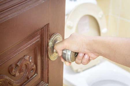 toilet: Opened door with toilet room Stock Photo