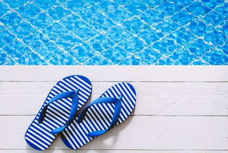 flip-flops on the swimming pool Stock Photo