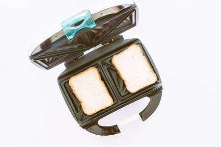 Toaster with bread slices making machine tool fast on white background Stock Photo