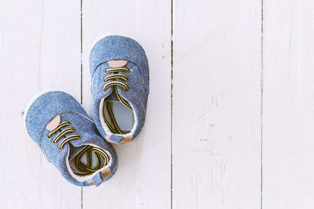 Baby shoes on wooden background Stock Photo