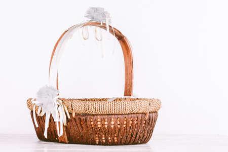 splint: Empty wicker basket on wooden table