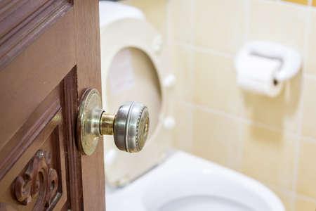 Opened door with toilet room Stock Photo