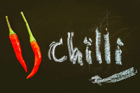 Red hot chili pepper on black background Stock Photo
