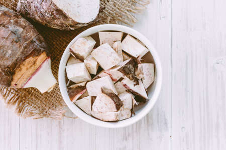 Taro root on wooden background