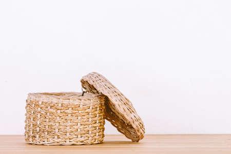 splint: Empty basket on wooden table