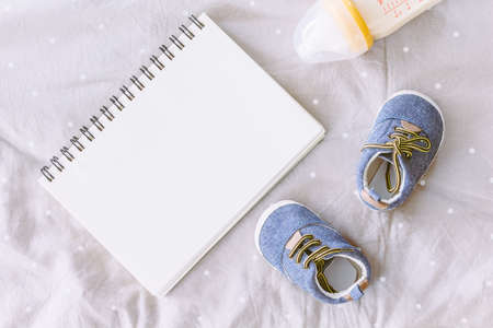 Baby shoes with book  on blanket