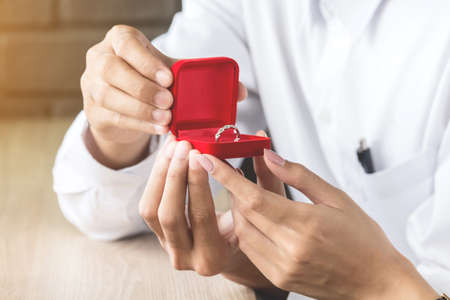 Man giving a ring for gift to a female