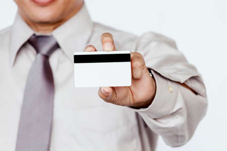 Businessman holding a credit card on white background Stock Photo