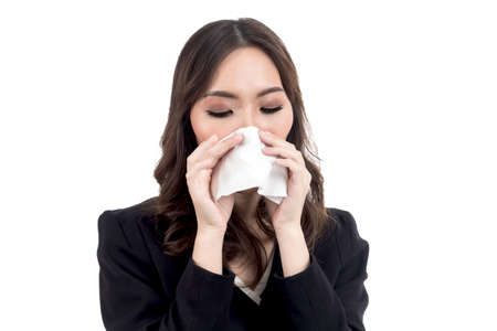 Sick woman blowing her nose with tissues isolated on white background